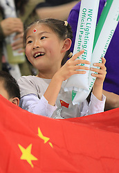 © Licensed to London News Pictures. London, UK. 27/04/2014. London, UK.  A Chinese girl watches the FINA Diving World Series final at the Aquatics Centre, Queen Elizabeth Olympic Park. Photo credit: LNP