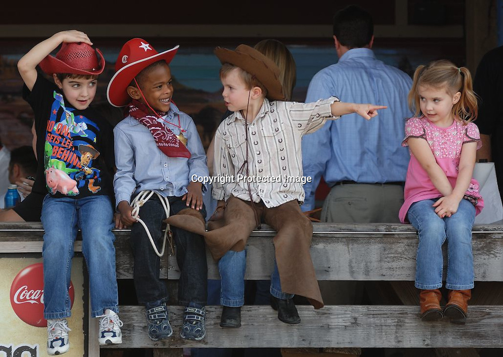 """Cowboys and cowgirl in the Fort Worth Stockyards. For """"Texas Highways"""" magazine."""