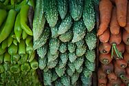 Vegetables stacked on a market stall, Kandy, Sri Lanka, Asia