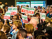 01 MAY 2019 - DES MOINES, IOWA: People wave banners protesting climate change at former Vice President Joe Biden's campaign rally in Des Moines. Biden is running to be the Democratic nominee for the US Presidency in 2020. He is campaigning in Iowa City and Des Moines today. Iowa traditionally hosts the the first selection event of the presidential election cycle. The Iowa Caucuses will be on Feb. 3, 2020.           PHOTO BY JACK KURTZ
