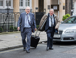 © Licensed to London News Pictures.23/03/2017.London, UK. Lords Bottomley (L) and Wakeham walk to Parliament through back streets, the day after a lone terrorist killed 4 people and injured several more, in an attack using a car and a knife. The attacker managed to gain entry to the grounds of the Houses of Parliament, killing one police officer.Photo credit: Peter Macdiarmid/LNP