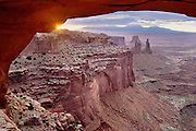 Sunrise through Mesa Arch, Islands District of the Canyonlands National Park, near Moab, Utah