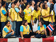 11 DECEMBER 2015 - BANGKOK, THAILAND:  People in Ratchaprasong Intersection wait for the Bike for Dad to start. More than 527,000 people registered for the Bike for Dad event to honor Bhumibol Adulyadej, the King of Thailand, whose birthday is also celebrated as Father's Day in Thailand. In Bangkok, 99,999 people registered for Bike for Dad. More than 418,000 people registered for Bike for Dad rides in the provinces outside Bangkok and 9,805 participated in Bike for Dad events outside of Thailand. His Royal Highness Crown Prince Maha Vajiralongkorn, the heir apparent to the Thai crown, led the bike ride in Bangkok. The Bangkok route was 29 kilometers long (18 miles) and traveled through Bangkok and across the Chao Phraya River into Thonburi. Bike for Dad events were held across Thailand.    PHOTO BY JACK KURTZ