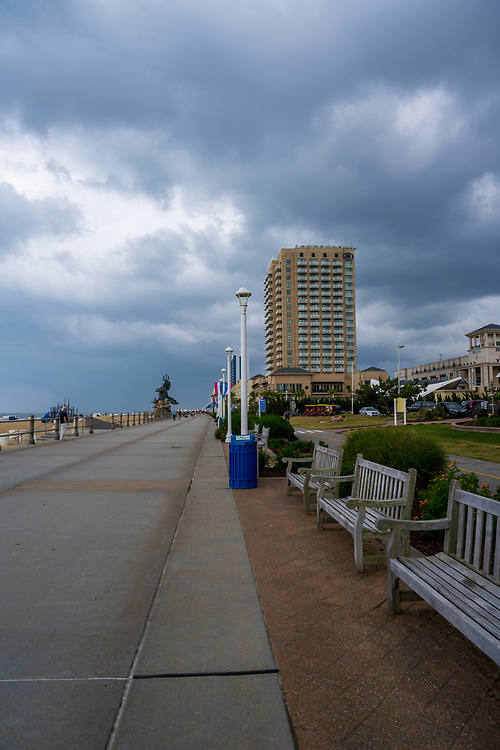 Virginia Beach, VA, USA -- Vertical wide-angle shot of the Virginia Beach boardwalk as storm clouds gather on a late spring afternoon.