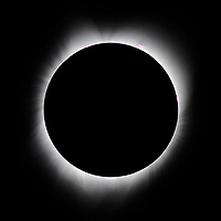 The moon passes in front of the sun during the 2017 solar eclipse Monday, Aug. 21, 2017, in Madras, Oregon.