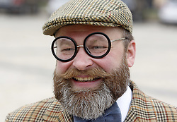 October 8, 2016 - Kiev, Ukraine - A man smiles as he attends a ''Tweed run'' or '''Retro Cruise'' on the St. Sophia Square in Kiev, Ukraine,on 08 October 2016. The participants are dressed in tweed jackets,wool golf socks and trousers, based on the British model,and ride on vintage bikes. (Credit Image: © Serg Glovny via ZUMA Wire)