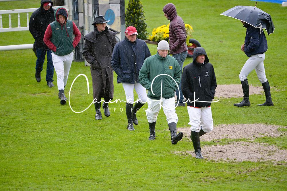 Course walk in the rain<br /> Paul EstermannCian O'Connor, Ludo Philippaerts, Scott Brash,<br /> Furusiyya FEI Nations Cup<br /> CSIO Sankt Gallen 2013<br /> © Hippo Foto - Katja Stuppia