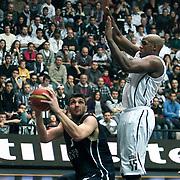 Besiktas's Ersin Daglı (R) and Anadolu Efes's Estaban Batista (L) during their Turkish Basketball league derby match Besiktas between Anadolu Efes at the BJK Akatlar Arena in Istanbul Turkey on Saturday 31 December 2011. Photo by TURKPIX