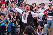 A Mexican clown performs for a crowd in the Macroplaza square in the Barrio Antiguo neighborhood of Monterrey, Nuevo Leon, Mexico.