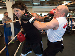 Federal Liberal Leader Justin Trudeau, left, exchanges lefts with Mickey MacDonald, a Halifax-area entrepreneur and philanthropist, at Palooka's Gym in Bedford, N.S. on Monday, August 25, 2014. MacDonald, a former competitive boxer, is hosting a fund-raising event at his residence for Trudeau later in the day. THE CANADIAN PRESS/Andrew Vaughan /ABACAPRESS.COM  | 521043_022 Bedford Canada