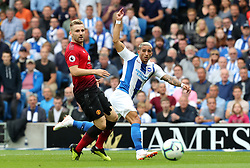 """Manchester United's Luke Shaw (left) and Brighton & Hove Albion's Anthony Knockaert (right) battle for the ball during the Premier League match at the AMEX Stadium, Brighton. PRESS ASSOCIATION Photo. Picture date: Sunday August 19, 2018. See PA story SOCCER Brighton. Photo credit should read: Gareth Fuller/PA Wire. RESTRICTIONS: EDITORIAL USE ONLY No use with unauthorised audio, video, data, fixture lists, club/league logos or """"live"""" services. Online in-match use limited to 120 images, no video emulation. No use in betting, games or single club/league/player publications."""