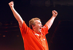 File photo dated 04-01-2004 of Phil Taylor celebrates after winning the Ladbrokes.com World Darts Championship Final against Kevin Painter at the Circus Tavern.