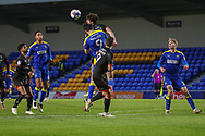 AFC Wimbledon striker Ollie Palmer (9) battles for possession and trying to win header during the EFL Sky Bet League 1 match between AFC Wimbledon and Lincoln City at Plough Lane, London, United Kingdom on 2 January 2021.