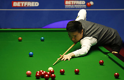 BRITAIN-SHEFFIELD-SNOOKER-WORLD CHAMPIONSHIP-DAY 4..(180424) -- SHEFFIELD (BRITAIN), April 24, 2018   Ding Junhui of China competes during the first round match with Xiao Guodong of China at the World Snooker Championship 2018 at the Crucible Theatre in Sheffield, Britain on Apr. 24, 2018. (Credit Image: © Craig Brough/Xinhua via ZUMA Wire)