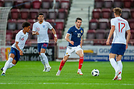 Lewis Morgan (#10) of Scotland U21s (Celtic FC) is surrounded by Reiss Nelson (#19) of England U21s (Hoffenheim, loan from Arsenal), Dominic Solanke (#20) of England U21s (Liverpool) and Kieran Dowell (#17) of England U21s (Everton) during the U21 UEFA EUROPEAN CHAMPIONSHIPS match between Scotland and England at Tynecastle Stadium, Edinburgh, Scotland on 16 October 2018.