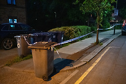 © Licensed to London News Pictures. 31/05/2021. London, UK. A small cordon on Booth Road following the fatal stabbing of an 18-year-old male at Montrose Park, Edgware. Metropolitan Police were called at 17:54 BST on Monday 31/05/2021 following reports of a group of males fighting. The man was found suffering from a stab injury in a tennis court area. He was treated by London's Air Ambulance and London Ambulance Service at the scene but was pronounced dead at 19:19 BST. Photo credit: Peter Manning/LNP