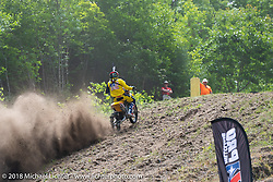 Racing up the hill at the Gunstock Hillclimbs during Laconia Motorcycle Week. NH, USA. Wednesday, June 13, 2018. Photography ©2018 Michael Lichter.
