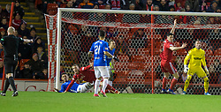 Referee Bobby Madden (left) awards Aberdeen a penalty during the Ladbrokes Scottish Premiership match at Pittodrie Stadium, Aberdeen.
