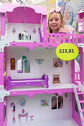 Scsrlett Thomas, who is just days away from her 9th birthday examines a dolls house at the Toy Fair at Kensington Olympia in London, the UK's largest dedicated game and hobby exhibition featuring the hottest and most anticipated products for the year ahead. London, January 22 2019.