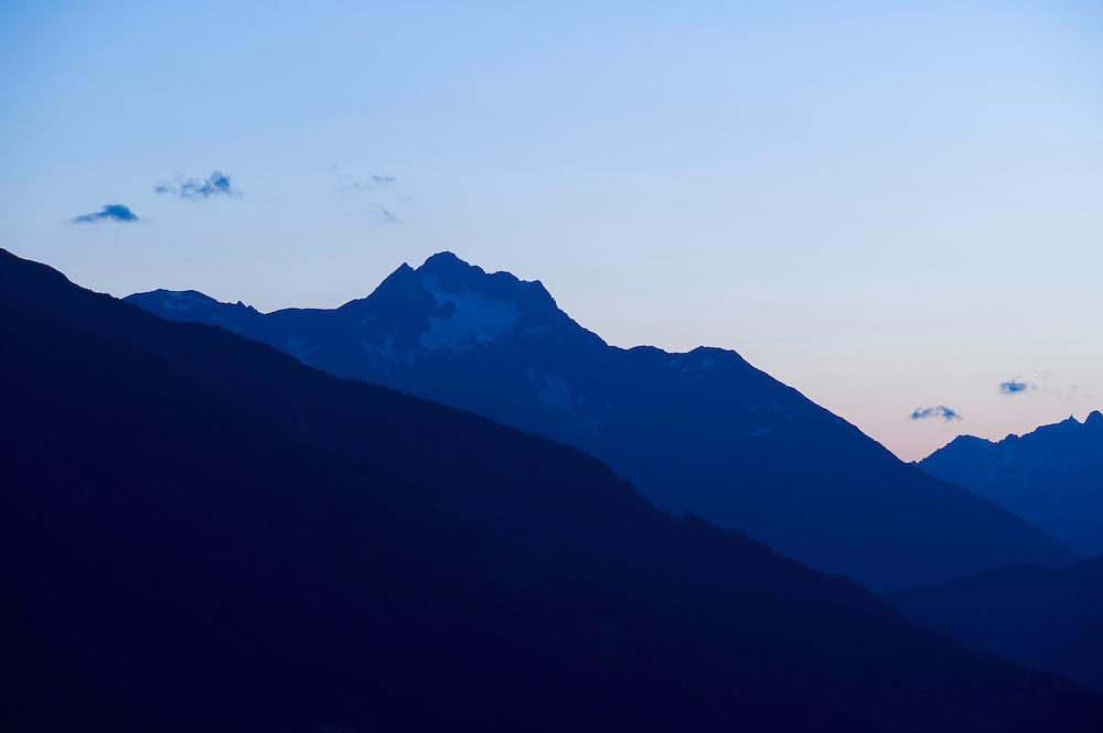 IFTE-NB-007871; Niall Benvie; panorama element; Alpine skyline from Kaunergrat visitor's centre; Austria; Europe; Austria; Tirol; mountain hill slope; horizontal; distant; blue; upland; 2008; July; summer; dusk evening; silhouette; Wild Wonders of Europe Naturpark Kaunergrat