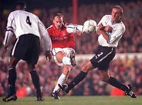 Dennis Bergkamp (Arsenal) shoots between Darryl Powell and Horacio Carbonari (Derby County). Arsenal 0:0 Derby County. F.A. Premiership, 11/11/2000. Credit: Colorsport / Stuart MacFarlane.