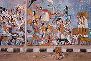 Modern hieroglyphic artwork painted on a wall of local wasteground in the village of Gezirat on the West Bank of Luxor, Nile Valley, Egypt. The pictures show the Battle of Kadesh which took place around 1274 BC between the forces of the Egyptian Empire under Ramesses II and the Hittite Empire under Muwatalli II at the city of Kadesh on the Orontes River. The battle is the earliest battle in recorded history for which details of tactics and formations are known. It was probably the largest chariot battle ever fought, involving perhaps 5,000–6,000 chariots.