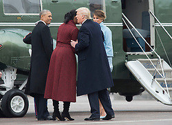 President Donald Trump talks to former First Lady Michelle Obama as he escorts her and former President Obama to a helicopter to depart the inauguration, on Capitol Hill in Washington, D.C. on January 20, 2017. President-Elect Donald Trump was sworn-in as the 45th President. Photo by Kevin Dietsch/UPI