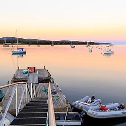 Boats on Mansett harbor at sunset on Mount Desert Island, Maine.