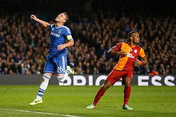 Chelsea Defender John Terry (ENG) looks frustrated as Galatasaray Forward Didier Drogba (CIV) looks on - Photo mandatory by-line: Rogan Thomson/JMP - 18/03/2014 - SPORT - FOOTBALL - Stamford Bridge, London - Chelsea v Galatasaray - UEFA Champions League Round of 16 Second leg.