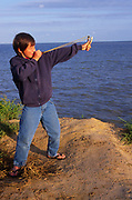 ATBJFF Boy firing his catapult into the sea
