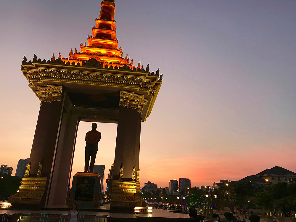 Sunset photo of the statue of King Father Norodom Sihanouk, Phnom Penh, Cambodia<br /> He was the King of Cambodia from 1941 to 1955 and again from 1993 to 2004, he was known as The King-Father of Cambodia