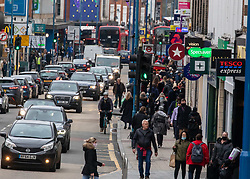 © Licensed to London News Pictures. 22/12/2020. London, UK. Long traffic jams in Putney, South West London as Christmas shoppers head out to the high street for last minute supplies and click & collect parcel pick ups. Yesterday a huge rush of shoppers descended on supermarkets causing long queues in the aisles and empty shelves after news of a French travel ban to Europe which blocked freight from leaving the Port of Dover after a spike of infections due to the Covid-19 mutation. Last week Prime Minister Boris Johnson put London and parts of the South East into Tier 4 lockdown after the new Covid-19 mutation was discovered. Photo credit: Alex Lentati/LNP