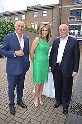 Left to right, Mr Robert Whyte, Mrs Diane Ipkendanz and ? at a party to celebrate the launch of Bentley's The Collection held at 6 Square Rigger Row, Plantation Wharf, York Road, London SW11 on 25th June 2012.