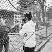 A kindergarten teacher talks to a concerned parent. All schools in Los Angeles were ordered closed.