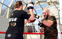 Tyson Fury (right) and Trainer Ben Davison during the public workout at Castle Court Shopping Centre, Belfast.