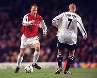 Dennis Bergkamp (Arsenal) takes on Seth Johnson (Derby). Arsenal 0:0 Derby County. F.A. Premiership, 11/11/2000. Credit: Colorsport / Stuart MacFarlane.