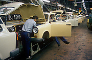 Six months after the fall of the Berlin Wall, the last Trabant cars come off the factory production line, on 1st June 1990, in Zwickau, eastern Germany former DDR. The DDR-produced Trabant suffered poor performance, but its smoky two-stroke engine regarded with affection as a symbol of the more positive sides of East Germany. Many East Germans streamed into West Berlin and West Germany in their Trabants after the opening of the Berlin Wall. It was in production without any significant change for nearly 30 years. The name Trabant means fellow traveler in German.