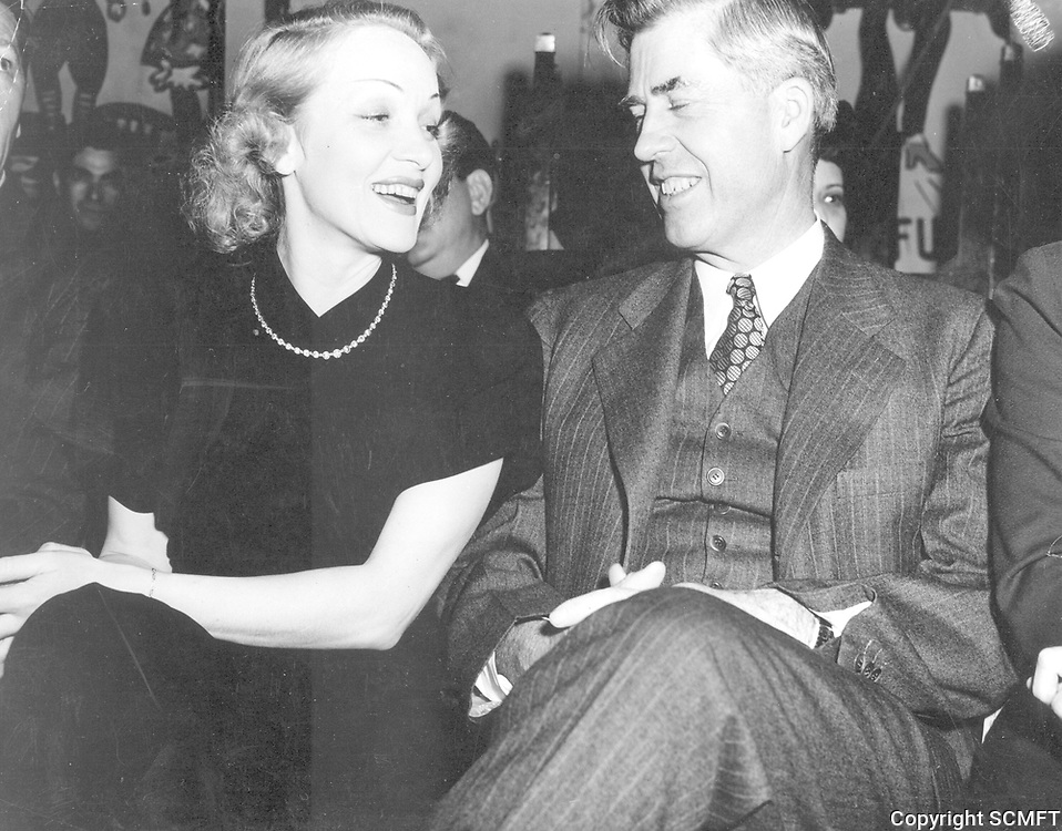1944 Marlene Dietrich chats with U.S. Vice President, Henry Wallace when he visited the Hollywood Canteen