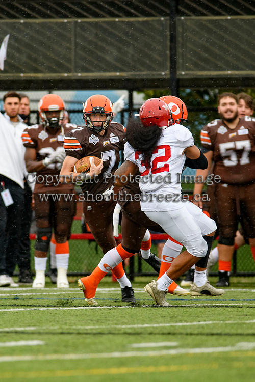 CHILLIWACK, BC - SEPTEMBER 11: Garrett Cape #2 guards Isaac Wegner #7 of Okanagan Sun as he runs with the ball against the Westshore Rebels at Exhibition Stadium in Chilliwack, BC, Canada. (Photo by Marissa Baecker/Shoot the Breeze)