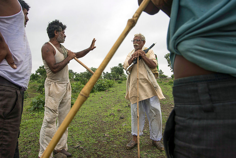 Talegaon raghuji: Hira chauhan, ramesh sathe and Praful in a discussion about a recent incident where the forest officers asked the pastoralists to stop grazing their cattle. They strongly refused ans asked the officials to arrest them.