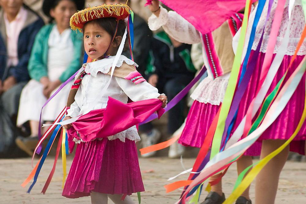 A young girl performs in a dance competition held in Llamay, near Cusco, Peru during the festival for Santa Rosa de Lima, South America's first catholic saint.