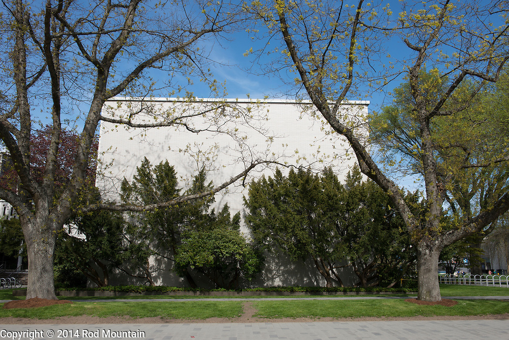 Trees and shrubs partially cover the exterior of a building at the University of British Columbia, Vancouver, BC