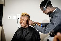 May 3, 2018 - Merelbeke, Belgique - Samuel Kalu forward of KAA Gent pictured with his hairdresser (Credit Image: © Panoramic via ZUMA Press)