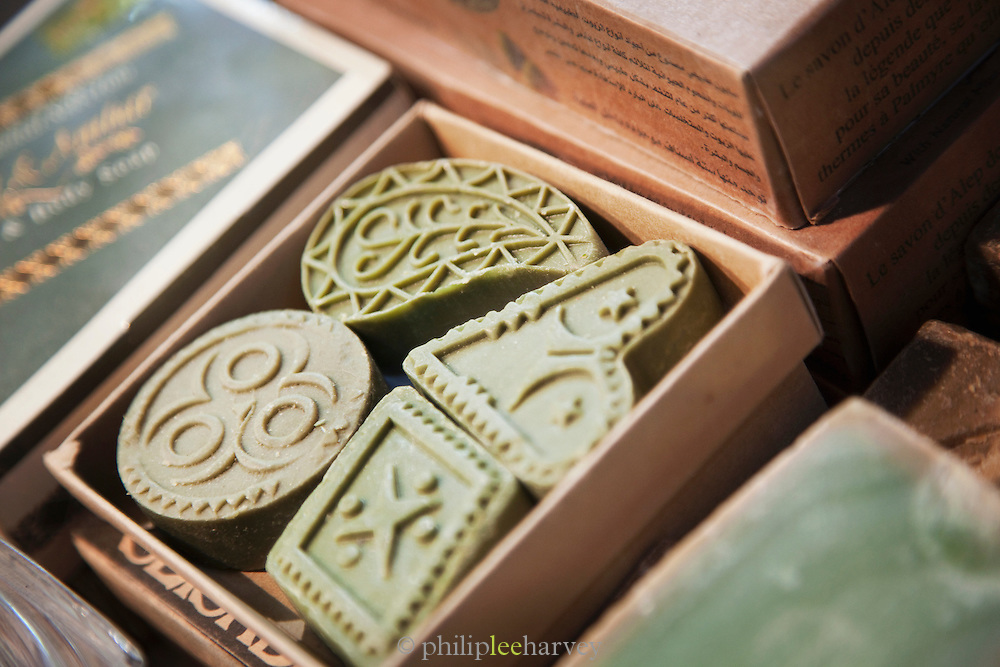 Olive soap bars for sale at a stall in a souq in the Old City in Damascus, Syria