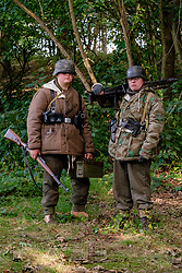Reenactors dressed in late War German winter clothing both are wearing Parkas and Steel helmets, Short Boots and Gaiters carrying the Mauser K98 Rifle. One also has a Panzerfaust antitank weapon<br />