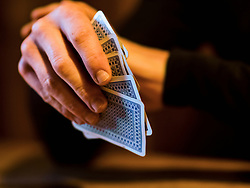 Close-up of hands holding playing cards