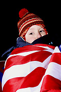 Kosovo, Pristina<br /> Saturday (evening), February 16, 2008<br /> <br /> Celebration's before declaration of Independent for Kosovo<br /> An Albanian little kid, his father cover his body with American national flag.