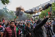 """Demonstrators light flares and shout anti-Taliban slogans during a protest """"Save Afghanistan"""" near Marble Arch in central London against the Taliban on Saturday, Aug 21, 2021. (VX Photo/ Vudi Xhymshiti)"""