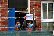 Refugees inside the barracks came out to enjoy the locals 'Welcome To Folkestone' event from local residents and community groups including Kent Refugee Action Network and Samphire came together outside Napier Barracks to show the people staying there that they are welcome to the town on the 17th of October 2020 in Folkestone, United Kingdom. In September 2020 Napier Barracks a former military camp was transformed into an assessment and dispersal facility for 400 asylum seekers by the Home Office. (photo by Andrew Aitchison / In Pictures via Getty Images)