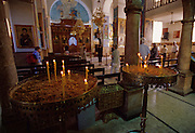 """Interior of the Greek Orthodox church of St. George which is located in Madaba, Jordan, which is also called """"the City of Mosaics""""."""